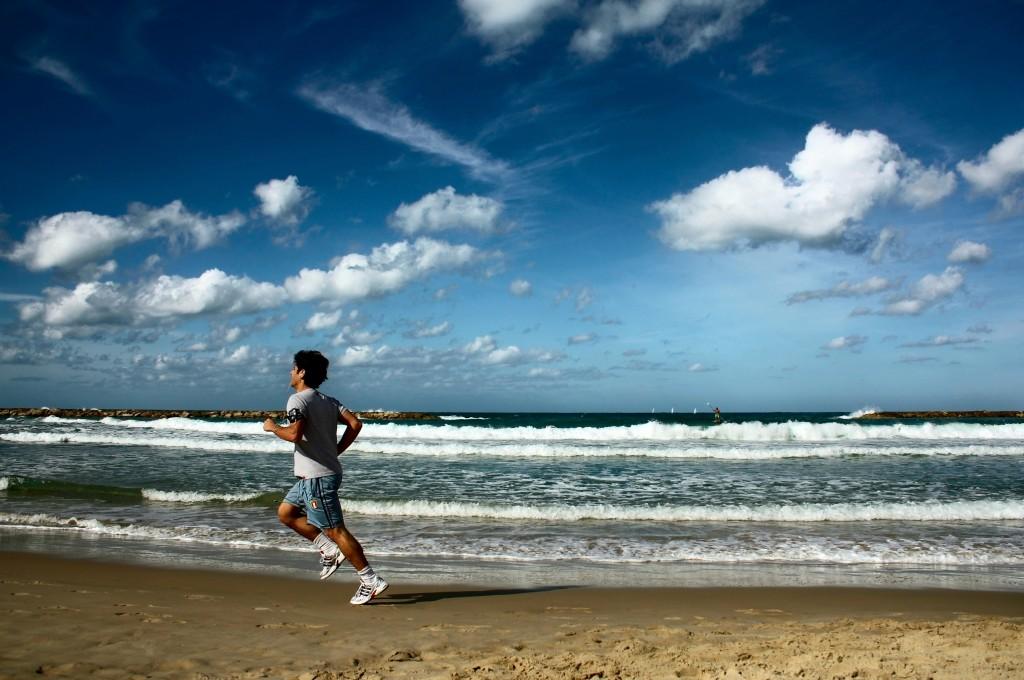 sportsman running on the beach in TelAviv