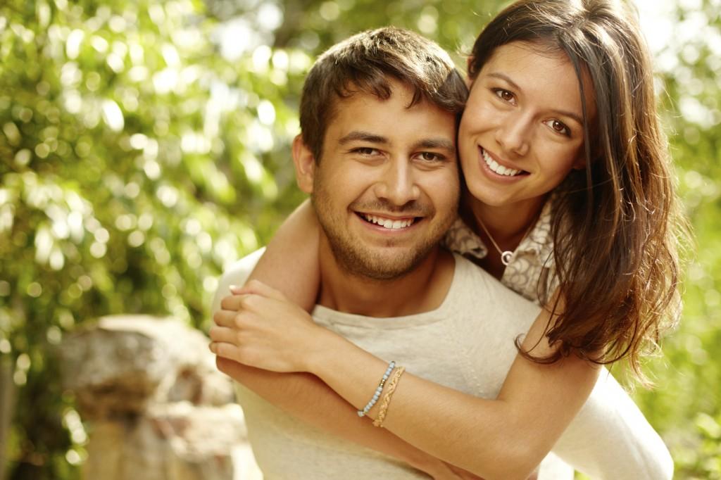 Cheerful couple having fun on summer vacation