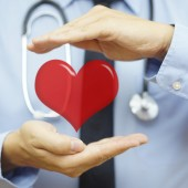 doctor is protecting heart  with hands. Health care and  Cardiov