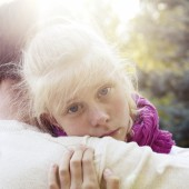 Daddy reassured his daughter.Little Girl resting on her father's