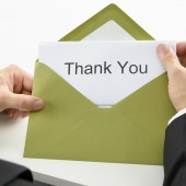 Businessman Holding Thank You Card