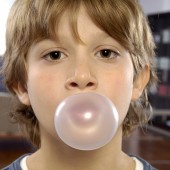 Young Boy with chewing gum