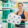 woman buys toilet paper in the supermarket