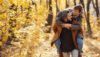 Couple spending free time enjoing beautiful autumn day