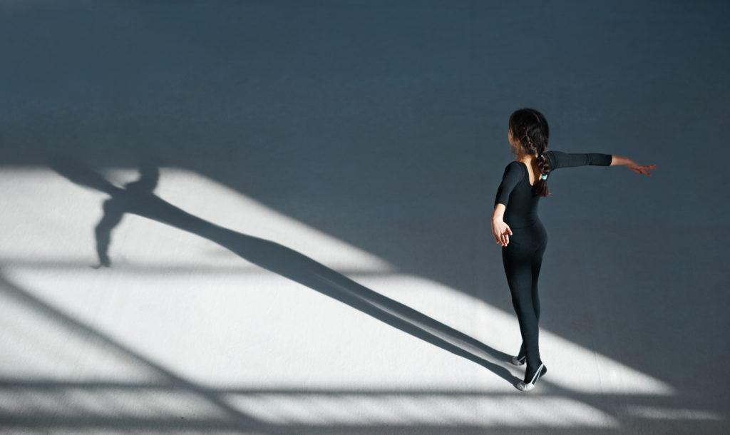 girl dancing in the hall rhythmic gymnastics