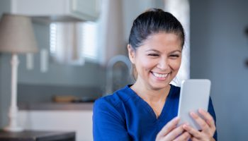 Nurse or doctor video chatting with patient during appointment while working from home