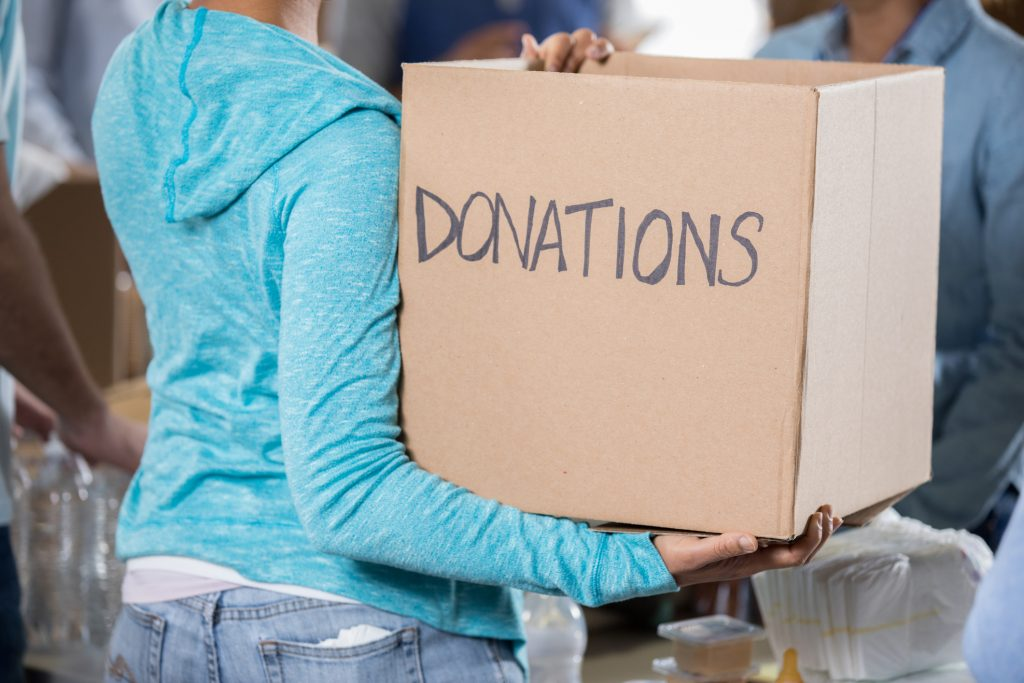 Unrecognizable woman holding donation box