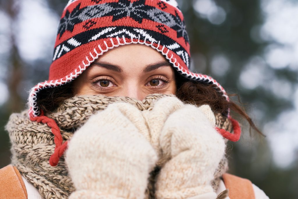 Funny woman trying to keep warm in winter